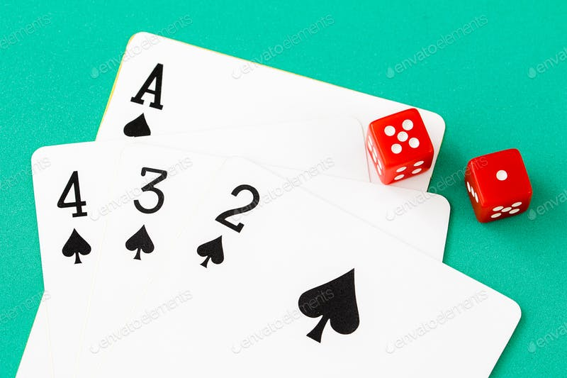 Dices+and+cards+on+green+casino+table-12